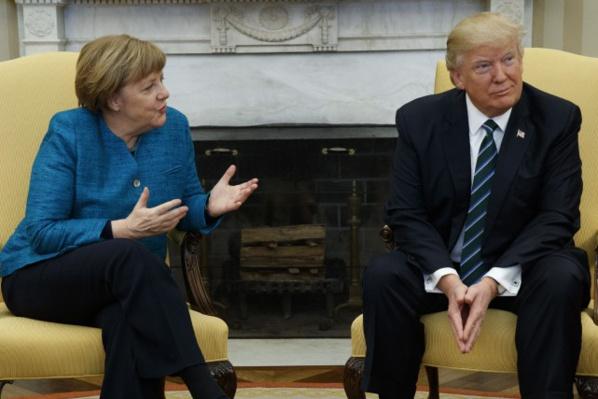 Trump/Merkel: premier contact délicat et divergences flagrantes