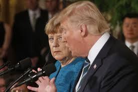 """Trump au côté de Merkel: """"je ne suis pas un isolationniste"""""""