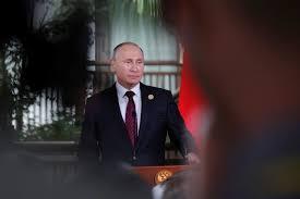 """Poutine dénonce une """"attaque"""" sur RT aux USA, promet une """"riposte"""""""